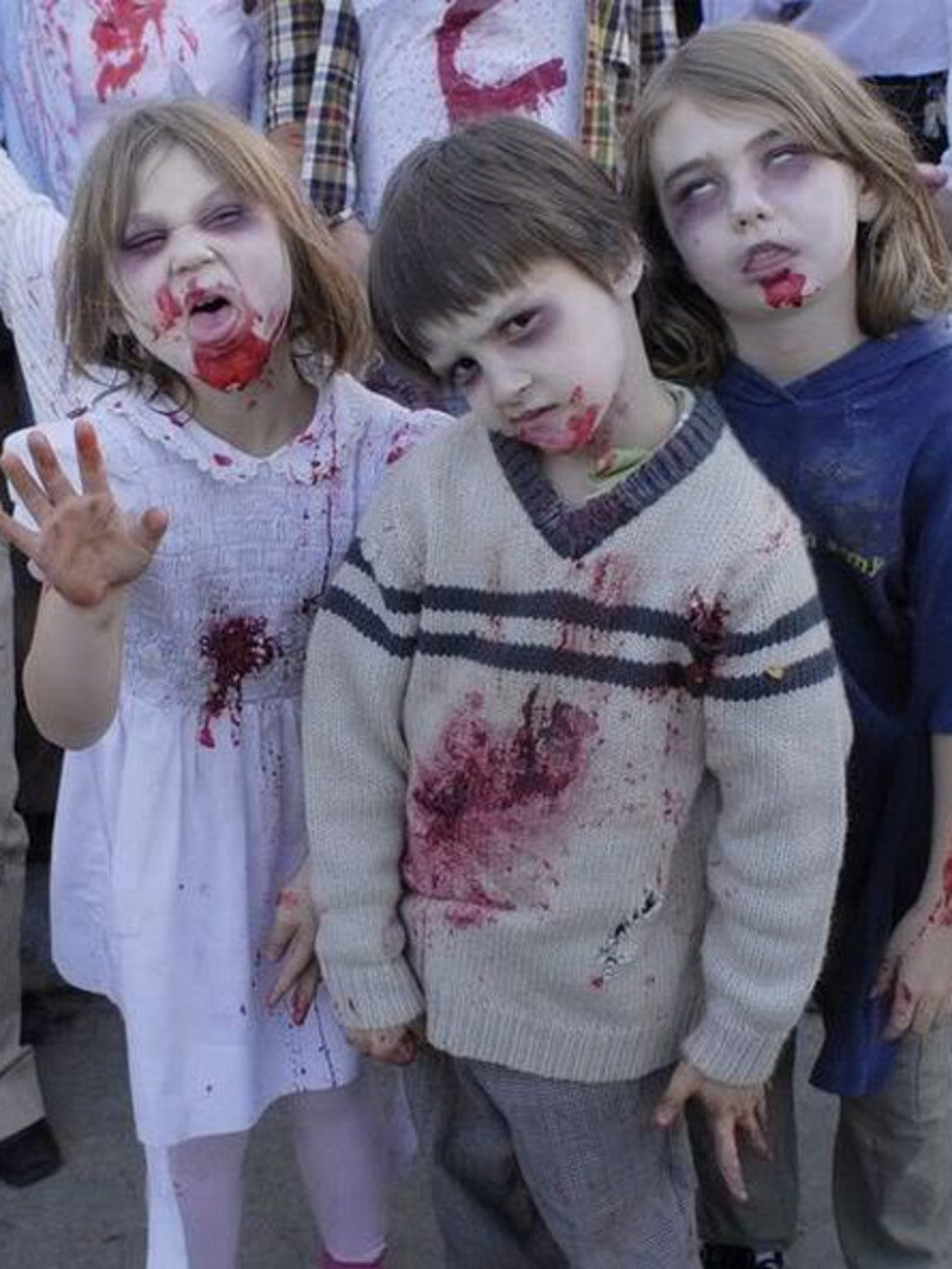 Kids participate in a previous Zombie Walk in Downtown