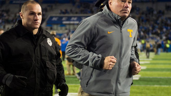 Tennessee Head Coach Butch Jones runs off the field after Tennessee's game against Kentucky at Kroger Field in Lexington on Saturday, Oct. 28, 2017.