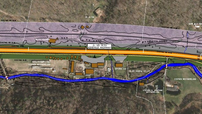 This map shows what a typical section of U.S. 19-23 would look like under plans proposed by the N.C. Department of Transportation. The roadway is shown in orange, a multi-use path in yellow and state right-of-way in green.