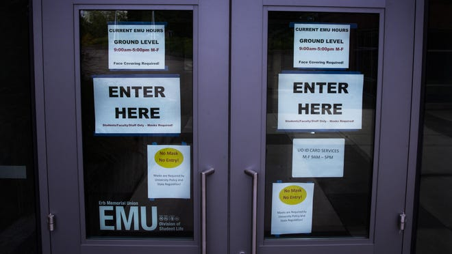 "The University of Oregon campus is beginning to show a few signs of life. Parts of the EMU are open to visitors with masks and the ""Closed"" signs are no longer in place on the grounds. [Chris Pietsch/The Register-Guard] - registerguard.com"