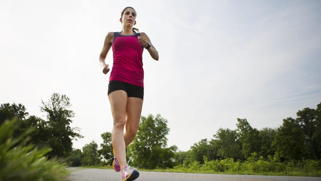 Miranda Melville of Rush race walks on the pathway along the Erie Canal in Henrietta.