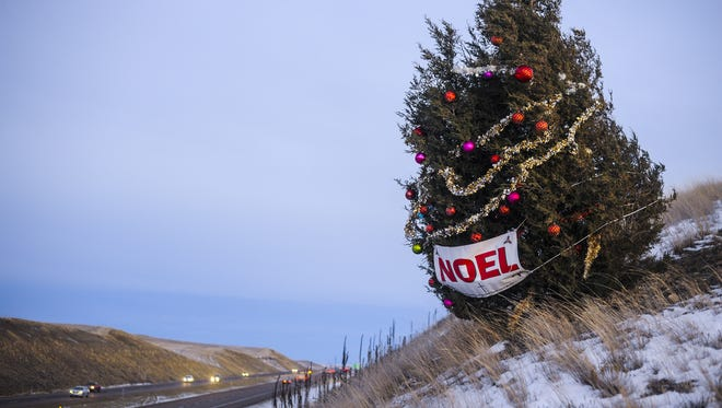 The Noel Tree stands alone by Interstate 15 near Manchester. It was decorated in memory of a Conrad teacher who admired the tree's tenacity.