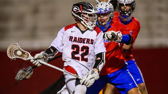 Greenville's Jacob Hall (22) works against Riverside's Shane Obuszewski during the Red Raiders' 12-11 win over the Warriors' March 13 at Sirrine Stadium.