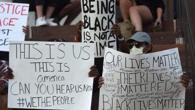 Protestors gathered at Wilmington City Hall in downtown Wilmington, N.C., Monday, June 1, 2020. Additional protests and vigils are being planned in the area in response to the death of George Floyd.