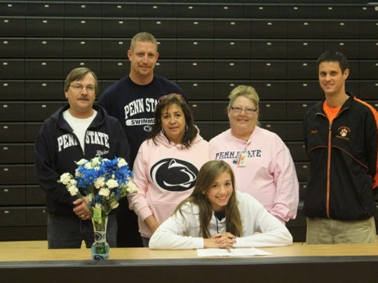 Niki Price will swim at Penn State University.  In the photo with Niki (from left to right) are father, Jim Price; mother, Debe Price; friend, Brenda Lemkelde; Coach Dan Schaeberle; and in the back is Coach Rusty McCollum. (SUBMITTED)