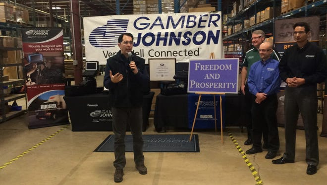 Gov. Scott Walker gives remarks during a tour of the Gamber Johnson company this month in Stevens Point, Wis.