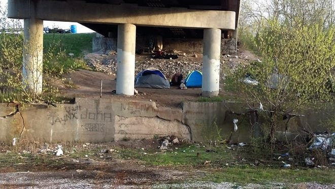 A homeless encampment near N. 25th St. and W. Greves St.: Milwaukee County should fully fund homeless shelters, the co-founders of Street Angels argue.