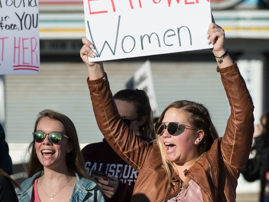 Salisbury University Student, Julia Mann, right, marches