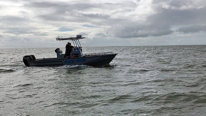 The Marine Patrol assists authorities searching for evidence of a single-engine plane that went missing shortly after taking off from a nearby airport with three people aboard the day before, Tuesday morning , Oct. 27, 2015, near Ocean Springs, Miss. The plane had been bound for South Carolina, but it was less than 50 miles east of the Gulfport-Biloxi International Airport when it lost radar contact Monday afternoon.