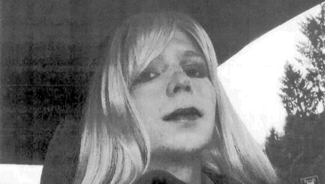 In this undated file photo provided by the U.S. Army, Pfc. Chelsea Manning poses for a photo wearing a wig and lipstick. Attorneys for the transgender soldier imprisoned in Kansas for sending classified information to the anti-secrecy website WikiLeaks said Monday, July 11, 2016, her hospitalization last week was due to an attempted suicide.