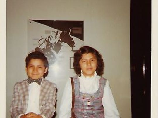 Rosa Luz and her brother Luis are pictured inside their apartment in Brooklyn, N.Y. Rosa Luz Catterall, now 53, estimates she was 10 or 11 in this photo. Her family came from Peru to New York, where they would live illegally for about 10 years until becoming citizens.