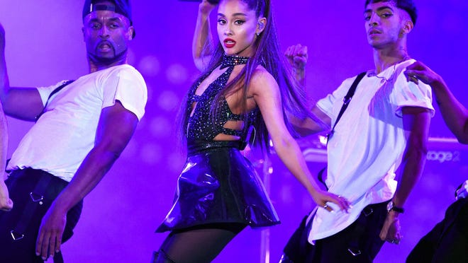 In this June 2, 2018 file photo, Ariana Grande, center, performs at Wango Tango in Los Angeles.