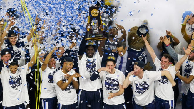 Villanova Wildcats players celebrate with the trophy after Monday's game against the North Carolina Tar Heels in the championship game of the 2016 NCAA Men's Final Four at NRG Stadium. Villanova won 77-74.