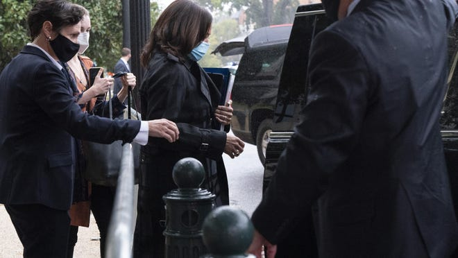 Democratic vice presidential candidate Sen. Kamala Harris, D-Calif., center, walks to a motorcade after leaving her office, Monday, Oct. 12, 2020, on Capitol Hill in Washington. On Monday, Harris testified remotely from her office during Supreme Court nominee Amy Coney Barrett's confirmation hearing before the Senate Judiciary Committee because of the pandemic.
