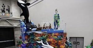"""People view SeaWorld's """"A Sea of Surprises"""" float during a preview of new Macy's Thanksgiving Day Parade floats in Moonachie, N.J., on Nov. 19."""