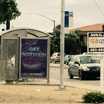 A bus shelter near Alma School Road and Chandler Boulevard includes a billboard for advertising.