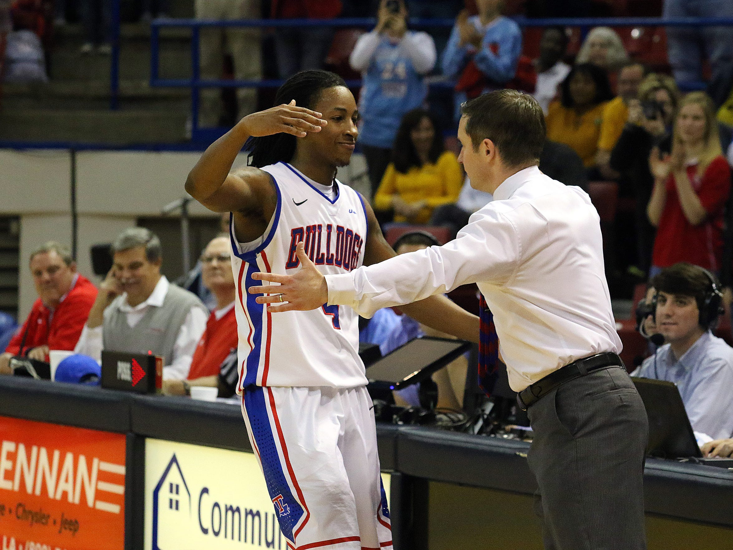 Louisiana Tech coach Michael White, right, and senior