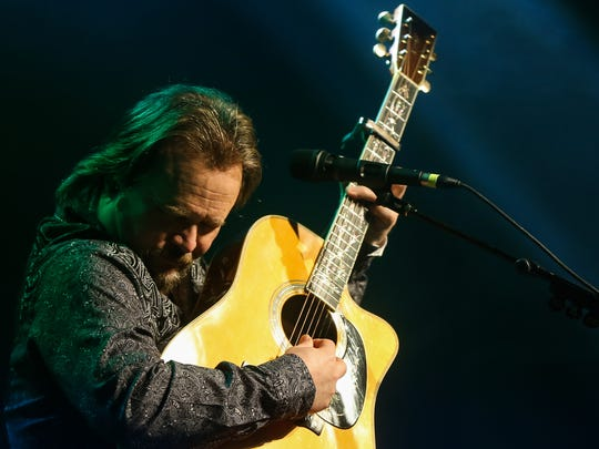 Travis Tritt plays his guitar for an acoustic performance Tuesday, Jan. 10, 2017, at the McNease Convention Center.