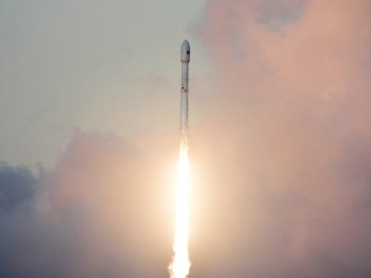 A SpaceX Falcon 9 rocket takes off from 39A