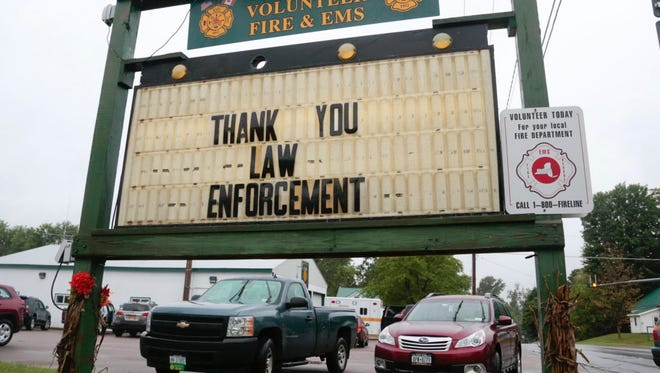 A sign at the Constable Volunteer Fire and EMS thanks law enforcement after the second of two escaped prisoners was apprehended June 28, 2015, in Constable, N.Y.