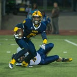 Battle Creek Central's RB Cyntell Williams in game action on a kick-off return late in the first quarter Friday night.