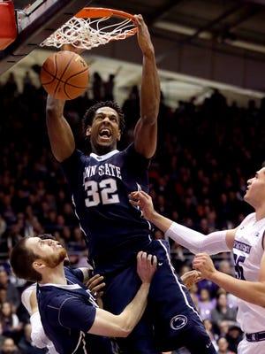 Penn State center Jordan Dickerson (32) dunks against Northwestern during the first half Saturday. Penn State won 71-62.