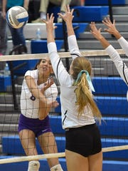 Bronson's Keona Salesman (8) goes for the kill during game action Tuesday night.