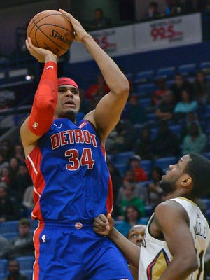 Tobias Harris shoots against Pelicans forward Darius Miller in the first half of the Pistons' 112-109 loss on Monday.