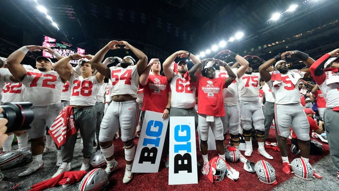 In this Dec. 8, 2019, file photo, Ohio State players celebrate the team's 34-21 win over Wisconsin in the Big Ten championship game.