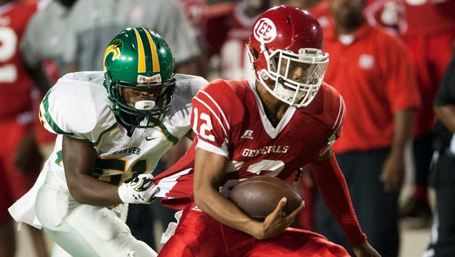 Lee's Michael Huntley, Jr., carries against Carver at Cramton Bowl in Montgomery, Ala., on Friday September 23, 2016.