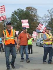 Striking Arbor Hills landfill workers walked the picket line Tuesday with support from others in their union and local Teamsters members.