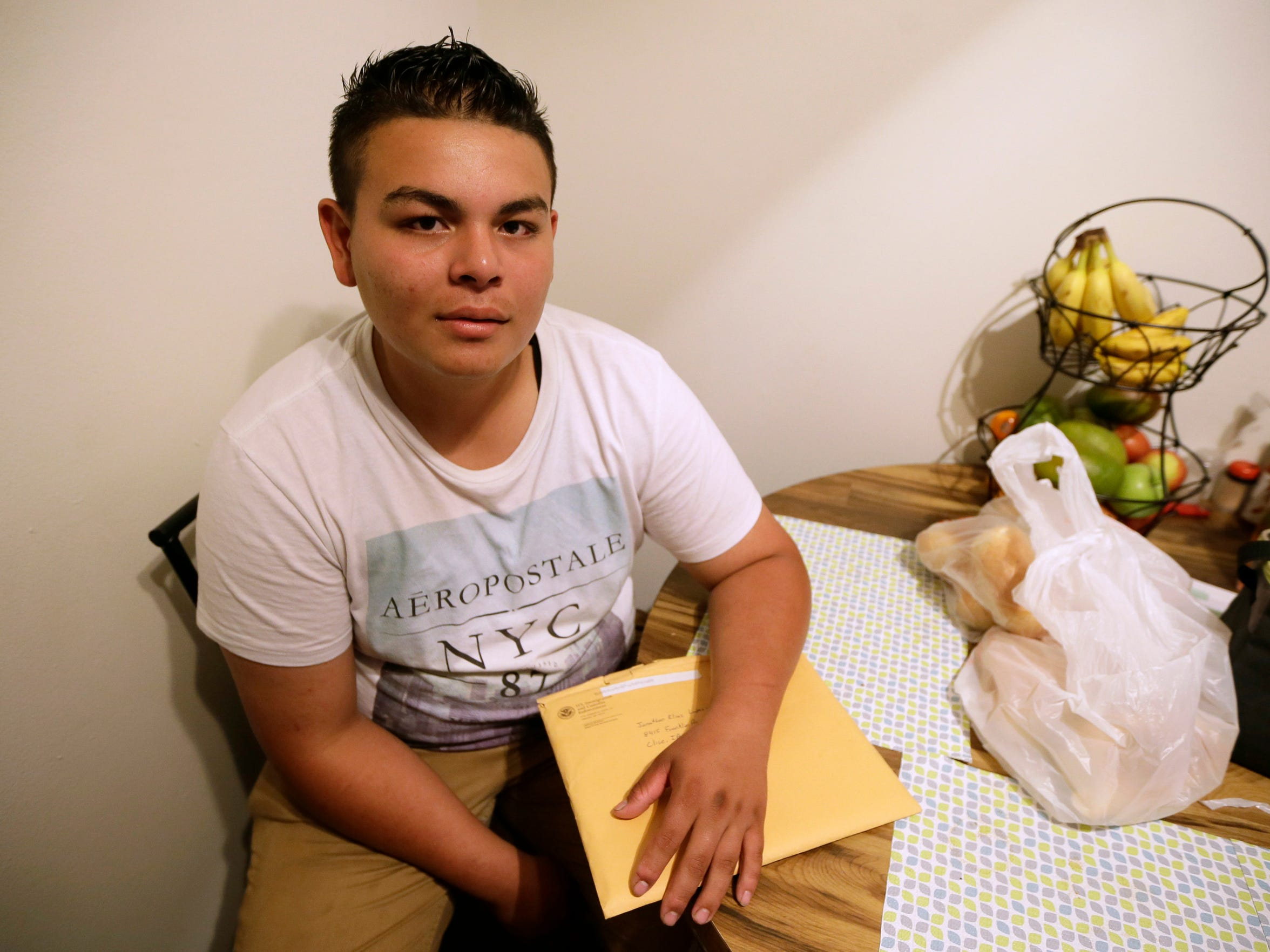 Jonathan Lopez, of Des Moines, Iowa, holds an envelope containing some of the paperwork for his asylum application on May 10 in Clive, Iowa.