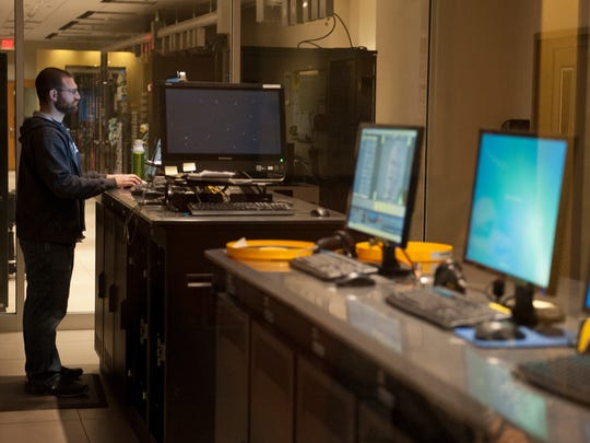 An employee works in the data distribution room at NFL Films headquarters in Mount Laurel.