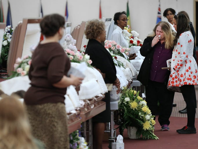 Friends, family and the community mourn during the celebration of life visitation for the six Guerra family members at New Wineskin Ministries on Thursday, March 6, 2014. Doors opened at 4 p.m. and long lines of people waited to stop at each of the six caskets to say their final goodbyes after the six family members perished in the fire on North Olney Street.