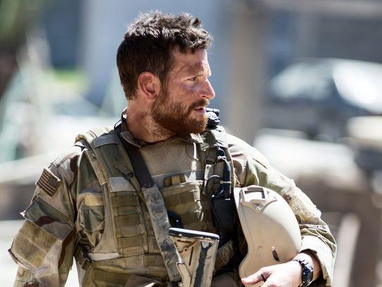 "Bradley Cooper portrays Chris Kyle in ""American Sniper."""