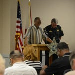 Escambia County Sheriff David Morgan prays with the Rev. John L. Philpot Sr. during a church security workshop Thursday night.