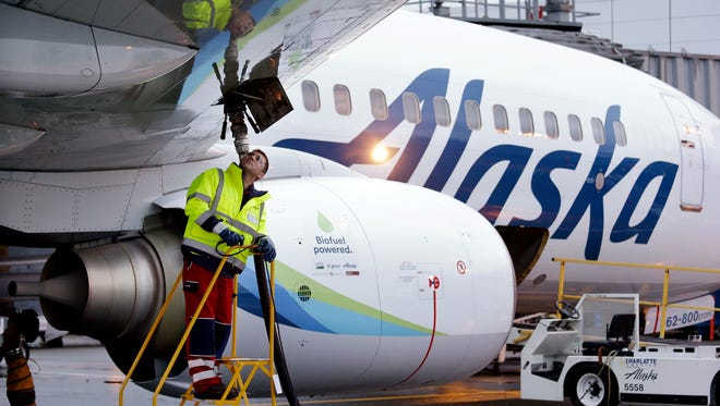 Fueling manager Jarid Svraka looks on as he fuels an Alaska Airlines Boeing 737-800 jet at Seattle-Tacoma International Airport in SeaTac, Wash.