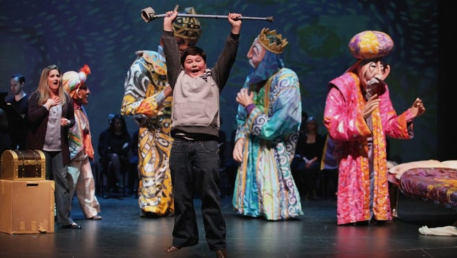 """Amahl, sung by Eric Riedel, 11, discovers he is no longer crippled in """"Amahl and the Night Visitors"""""""