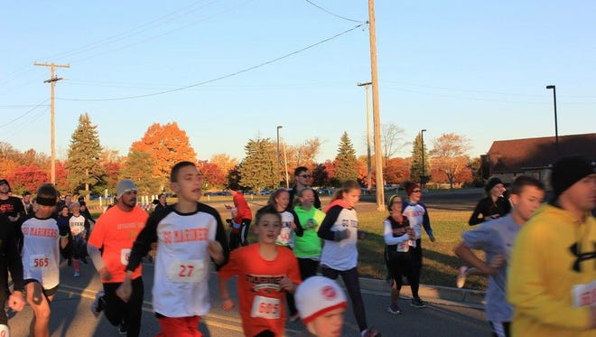 Participants of the Blue Water Rivalry Run in Marysville