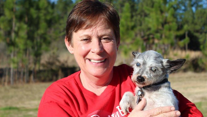Virginia Cheatham poses with Lola, who was rescued from a puppy mill in Purvis. Cheatham was recently awarded the annual Advocates We Love Award from the Humane Society of the United States.