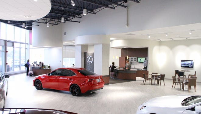 The newly remodeled Willis Lexus auto dealership in Clive features an expanded showroom and customer waiting area.