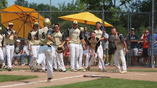 Franklin players await the arrival of Nathan Aide after he belted a home run July 17 in the WIAA playoffs.