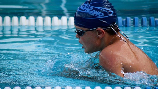 Highlands Hurricanes swimmer Chase Kenter heads for gold in the 50-meter breaststroke during the AAU Junior Olympics in Rochester, Michigan.