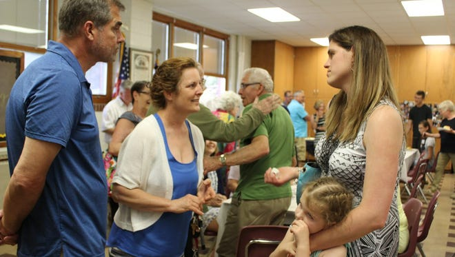 Former students and community members gather during St. Gregory Catholic School's legacy memorial celebration on June 16.