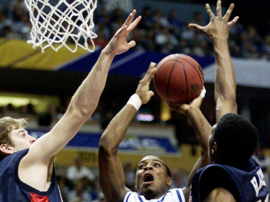 No. 4 Top 10 Sports Events: Cliff Hawkins of UK shoots over John Gunn and Josh Hayes of Ole Miss in the SEC Mens Basketball Tournament Championship game at the Gaylord Entertainment Center March 11, 2001.
