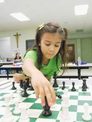 Seven-year-old Lillian Poliquin, a first grader at Holy Cross School in Dover, made a list announcing the top female chess players in the United States under 7 years old.