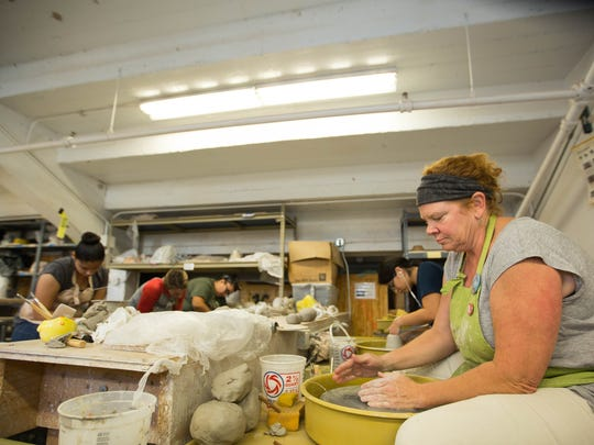 NMSU art major Bernadette Larimer, right, shapes ceramic on Wednesday, Oct. 5, 2016, in the ceramics classroom located under the east side of D.W. Williams Hall bleachers. Before the construction of the Pan American Center in the 1960's, D.W. Williams Hall was NMSU's gymnasium.