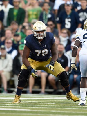 Sept. 19, 2015; South Bend, Ind.; Notre Dame Fighting Irish offensive lineman Ronnie Stanley (78) prepares to block Georgia Tech Yellow Jackets defensive lineman Antonio Simmons (93) at Notre Dame Stadium.