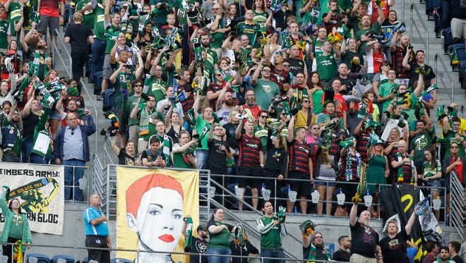 Portland Timbers supporters cheer in the first half of a MLS soccer match against the Seattle Sounders, Sunday, Aug. 21, 2016, in Seattle.
