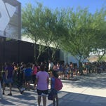 A line of eager parents and their children wrapped around the Maryvale YMCA.